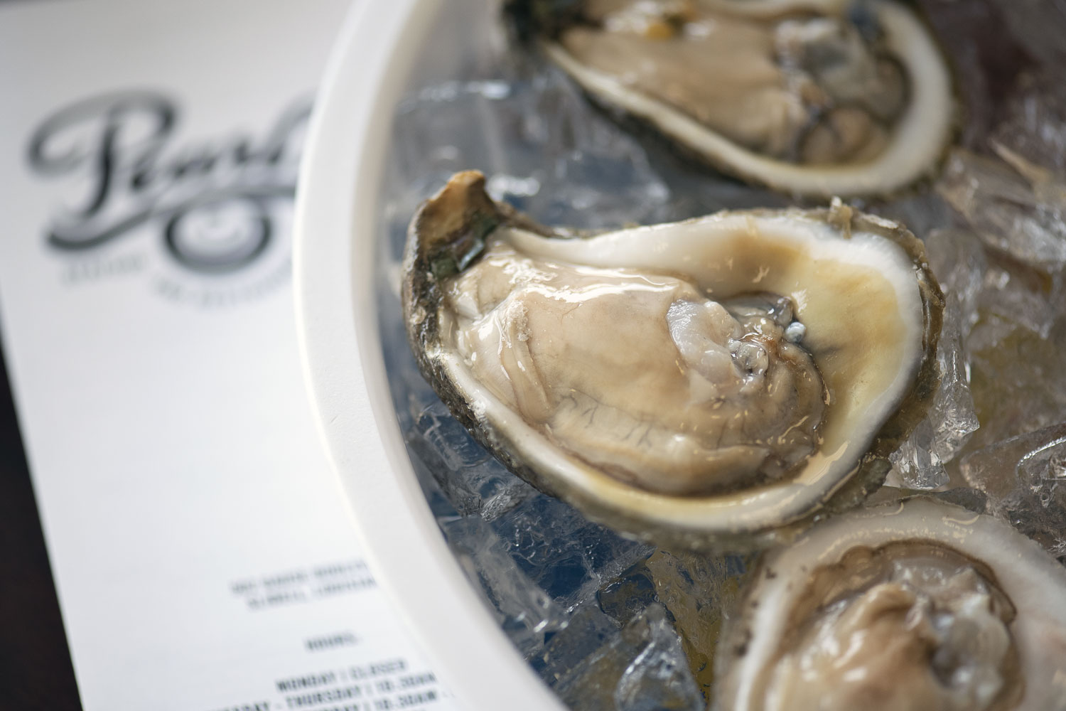 Raw oysters on the half shell at Pearl's Seafood in Slidell, photography by Cerberus Agency